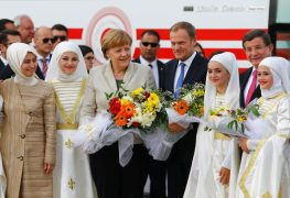 German Chancellor Merkel, EU Council President Tusk, Turkish Prime Minister Davutoglu and his wife Sare pose during a welcoming ceremony at Nizip refugee camp near Gaziantep