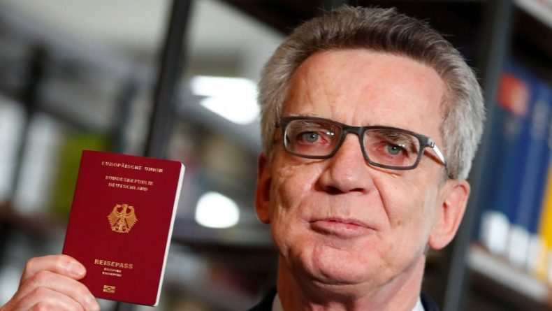 German Interior Minister de Maiziere presents the new electronic passport in Berlin